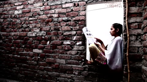 teenager girl reading a book at home - girls stock videos & royalty-free footage