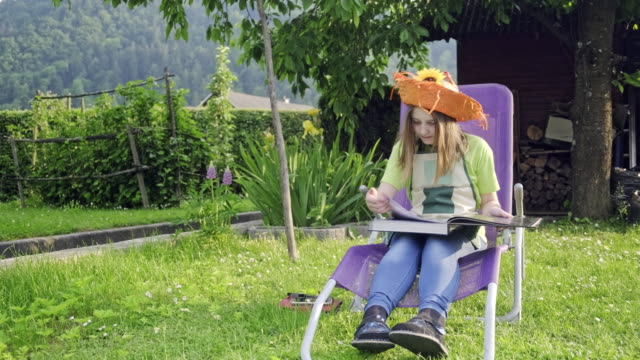teenager girl reading book in the garden - deck chair stock videos & royalty-free footage