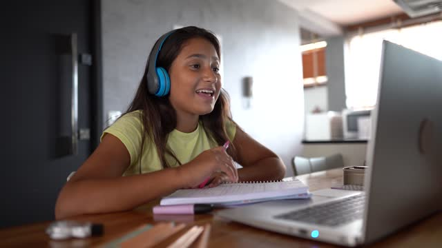 teenager girl using laptop on homeschooling watching a online class - latin american and hispanic ethnicity stock videos & royalty-free footage