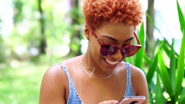 teenager girl using mobile - pardo brazilian stock videos & royalty-free footage