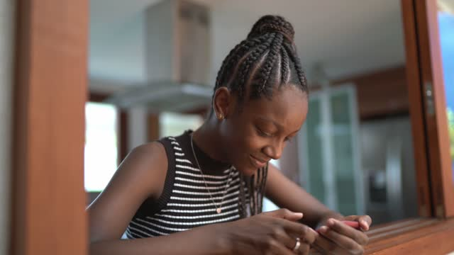 teenager girl using smartphone at home - handheld stock videos & royalty-free footage