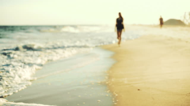 teenager girl walking on the beach in the sunny summer's day - long island stock videos & royalty-free footage