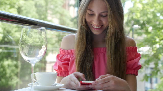 teenager girl writing message on smartphone in cafe - kharkov stock videos & royalty-free footage