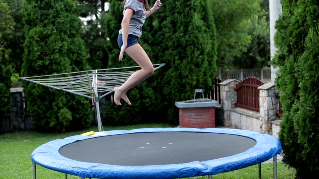 teenager having fun - jumping on a trampoline - 14 15 years stock videos and b-roll footage
