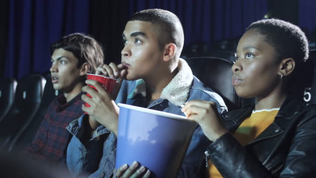 teenager hide behind food and drinks during horror movie, close up - film industry stock videos & royalty-free footage