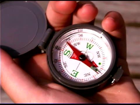 teenager holding compass - endast en tonårspojke bildbanksvideor och videomaterial från bakom kulisserna