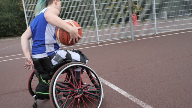 teenager in wheelchair playing basketball - disability sport and recreation - cerebral palsy stock videos & royalty-free footage
