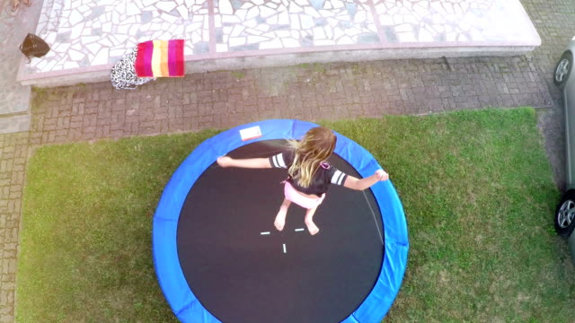 teenager jumping on the trampoline 2
