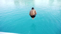 Teenager jumps into swimming pool