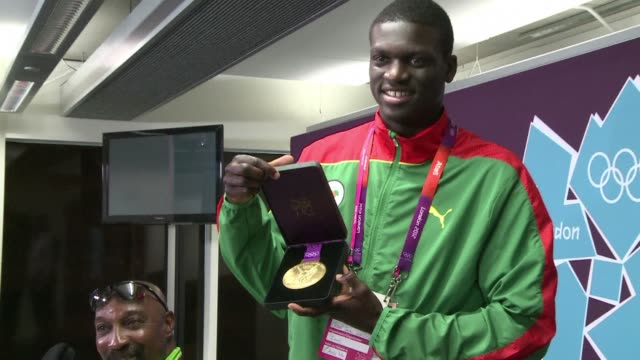 teenager kirani james powered to gold in the men's 400m to win grenada's first olympic medal of any colour and break the americans' 28year... - olympic medal stock videos & royalty-free footage