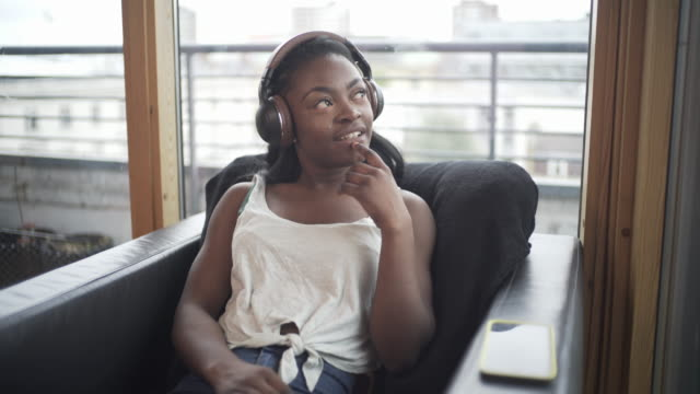A Teenager listening to a podcast
