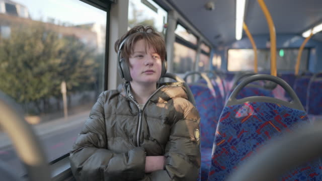 a teenager on the bus - teenage boys stock videos & royalty-free footage