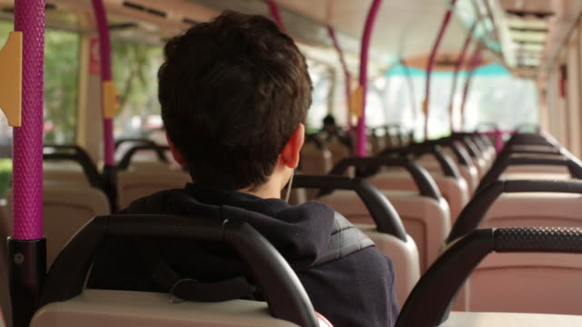 ms teenager sitting down on a bus - teenage boys stock videos & royalty-free footage
