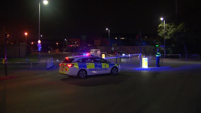 teenager stabbed in edmonton: crime scene; england: london: edmonton: ext / night police car with flashing lights, police officer and cordons on road... - directing stock videos & royalty-free footage