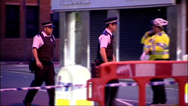 teenager stabbed to death in east london; england: london: ilford: ext police officers along near crime scene metropolitan police cycle task force... - ilford stock videos & royalty-free footage