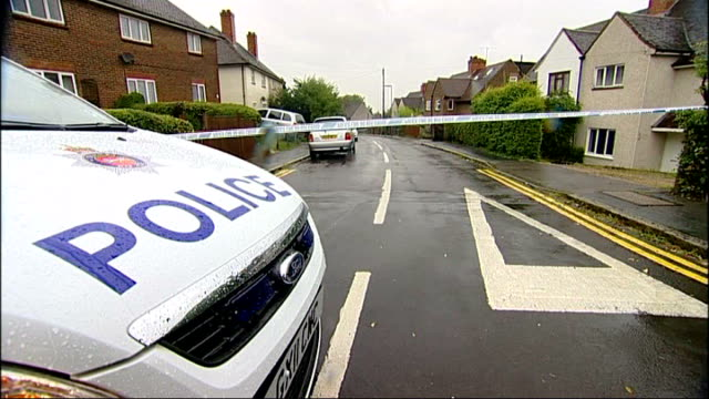 teenager stabbed to death in guildford england surrey guildford ext police car and police tape at crime scene police tape across fence outside house... - guildford stock videos and b-roll footage