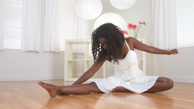 teenager stretching on the floor