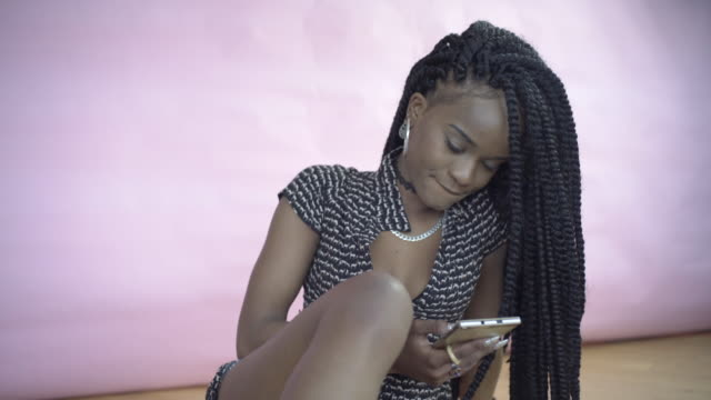a teenager using social media. - hoop earring stock videos and b-roll footage