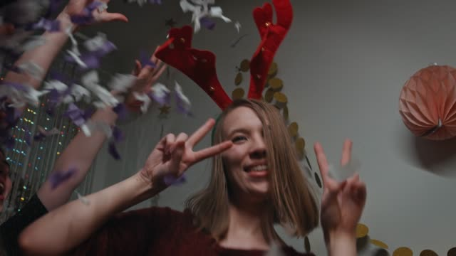 teenager with reindeer headband dancing in party - antler stock videos & royalty-free footage