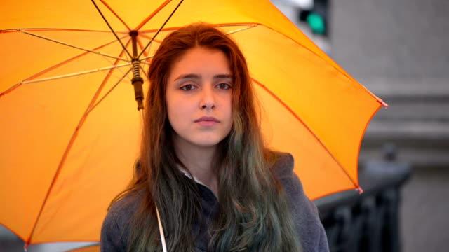 Teenager with umbrella