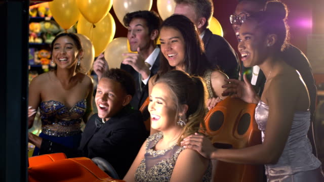 teenagers after prom at video arcade - secondary school child stock videos & royalty-free footage