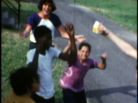 1973 MS Teenagers and kids playing around and wrestling at Camp Sussex summer camp / Sussex, New Jersey