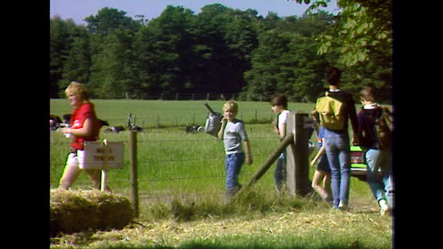 teenagers arrive at a summer camp in the uk; 1984 - jeans stock videos & royalty-free footage