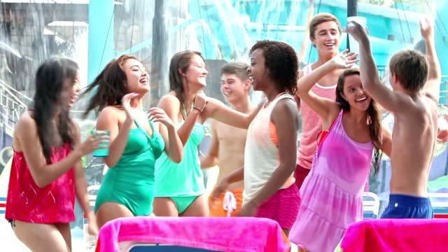 Teenagers at water park, dancing