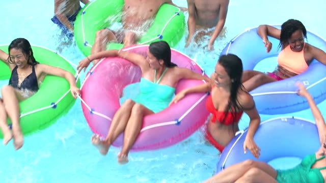 teenagers at water park playing on lazy river - laziness stock videos & royalty-free footage