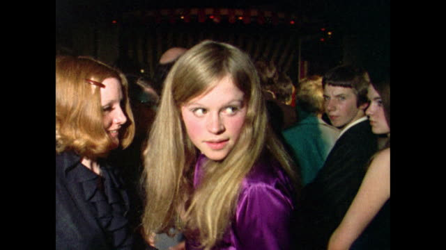 teenagers dance and look cool in a nightclub; 1969 - long hair stock videos & royalty-free footage