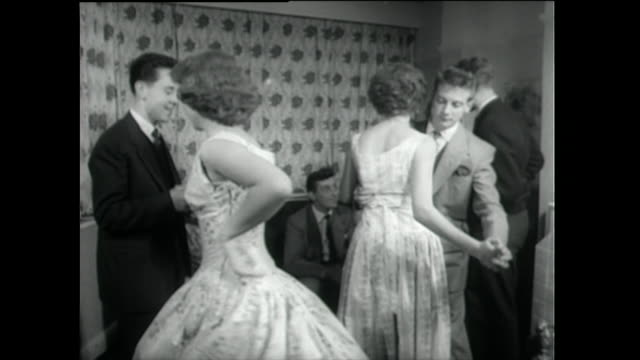 teenagers dancing rock and roll at house party; 1955 - teenage couple stock videos & royalty-free footage