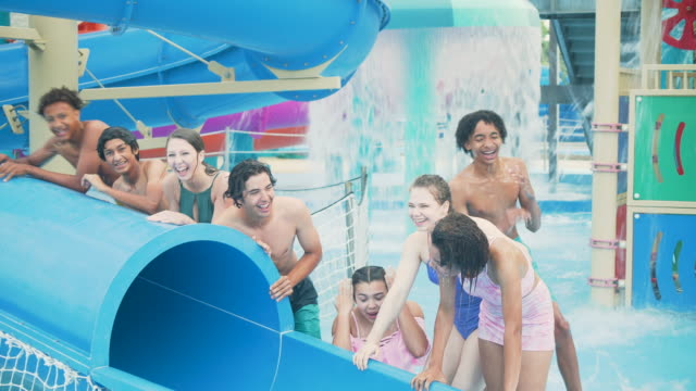 teenagers getting drenched in water park play area - drenched stock videos & royalty-free footage