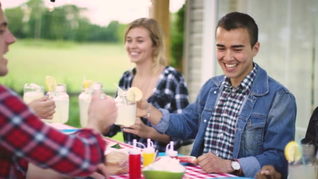 Teenagers hanging out and having a BBQ during Summer