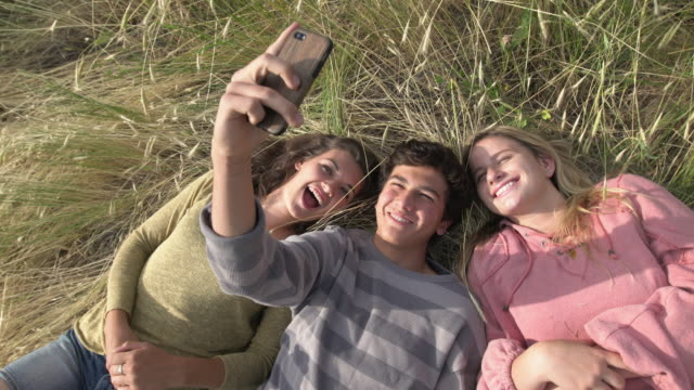 teenagers hanging out and having fun - lying down stock videos & royalty-free footage