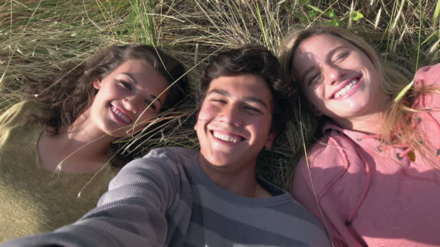 cu teenagers hanging out taking a selfie - non urban scene stock videos & royalty-free footage
