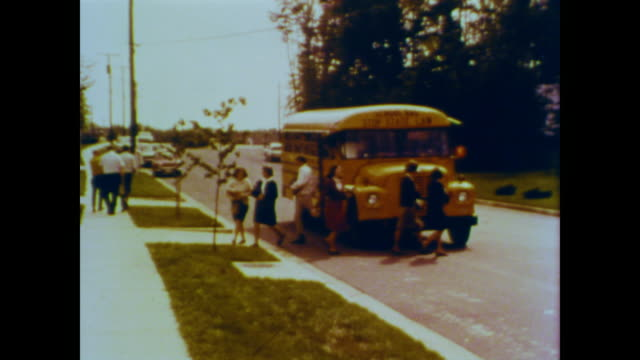 1966 teenagers in 1960s clothing get off a school bus in the suburbs - 1966 stock videos & royalty-free footage