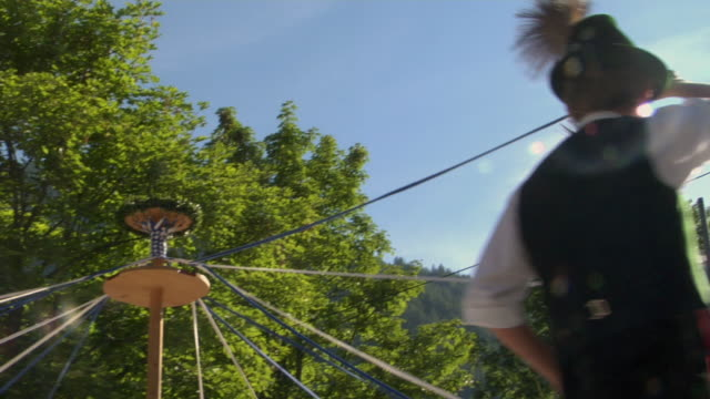 cu td teenagers in traditional clothing dancing around maypole at tegernsee folk festival, tegernsee, bavaria, germany - traditional dancing stock videos and b-roll footage