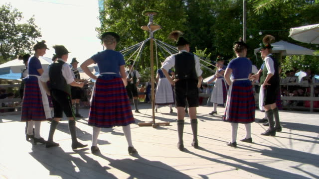 ws teenagers in traditional clothing dancing around maypole at tegernsee folk festival, tegernsee, bavaria, germany - traditional dancing stock videos and b-roll footage