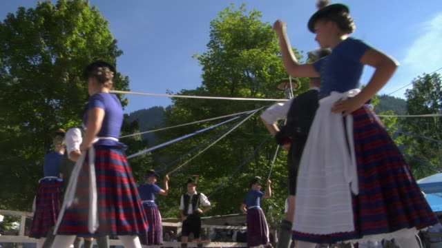ms la teenagers in traditional clothing dancing around maypole at tegernsee folk festival, tegernsee, bavaria, germany - traditional clothing stock videos & royalty-free footage