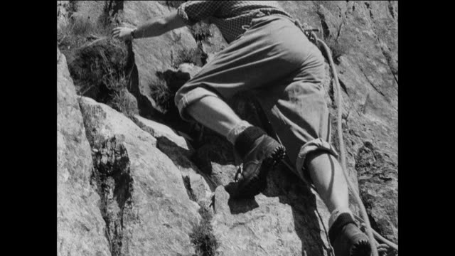 vídeos de stock e filmes b-roll de montage teenagers learn to rock climb at snowdonia u.k. national park / uk - 1930