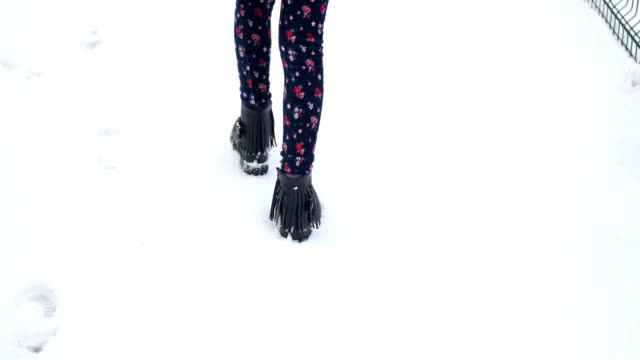 teenager's legs at the black boots on the snow - leather stock videos & royalty-free footage