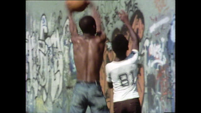 teenagers play basketball on outdoor courts; new york, 1976 - jeans stock videos & royalty-free footage