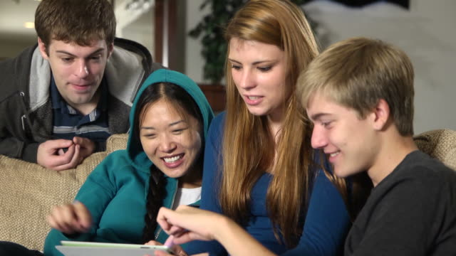 teenagers play with digital tablet - hooded top stock videos & royalty-free footage