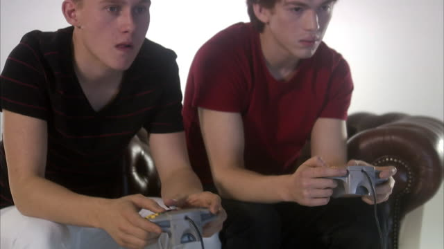 teenagers playing a video game. - gamepad stock videos & royalty-free footage
