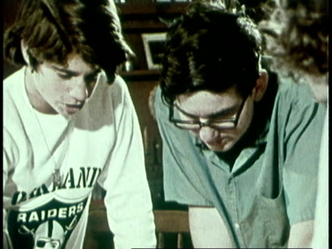 1973 MONTAGE teenagers playing board game / United States