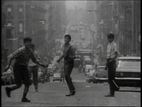 1965 ws teenagers playing frisbee on a bronx street / new york city, new york, united states - bronx stock videos and b-roll footage