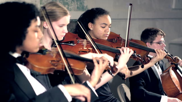 teenagers playing string instruments in concert - rack focus stock videos & royalty-free footage