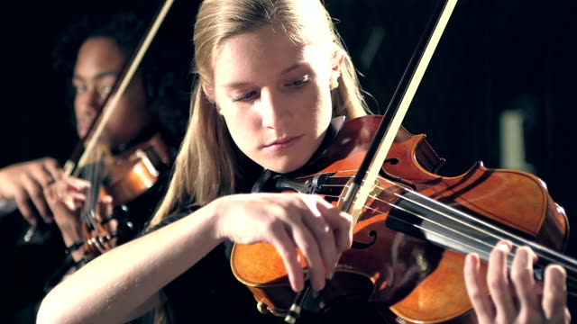 teenagers playing violin in concert - orchestra stock videos & royalty-free footage