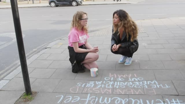 teenagers push for catcalling to be criminalised; uk, london, lambeth; campaigners doing chalk drawings. england: london: lambeth: ext various maria... - chalk art equipment stock videos & royalty-free footage