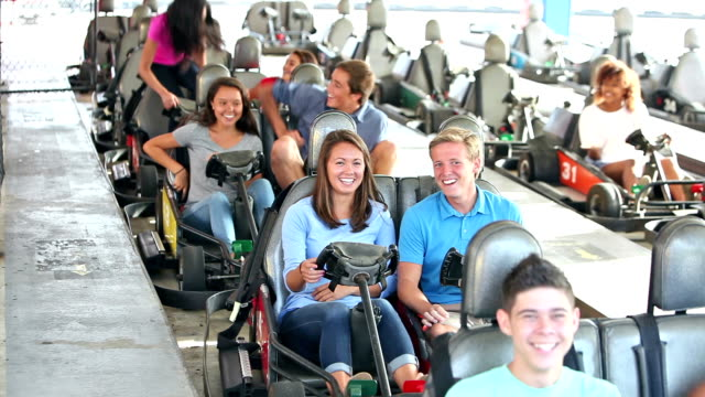 teenagers riding go-carts at amusement park, getting in - go cart stock videos & royalty-free footage